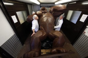 Assistants of French chocolate maker Jean-Paul Hevin work on a four-metre tall chocolate King-Kong created by Richard Orlinski in Colombes